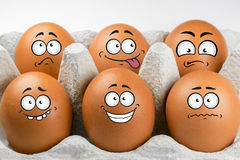 Eggs with faces and expressions. Eggs with faces and various expressions Royalty Free Stock Photos