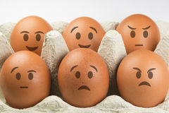 Eggs with faces Royalty Free Stock Photos