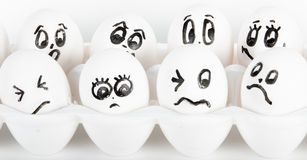 Eggs with faces Stock Photos