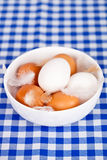 Eggs and feathers in a bowl Royalty Free Stock Photo