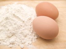 Eggs and flour Stock Photos