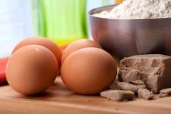 Eggs & flour. Brown eggs with fresh yeast and wheat flour Stock Photos