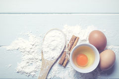 Eggs with flour. And cinnamon on a table Royalty Free Stock Photography