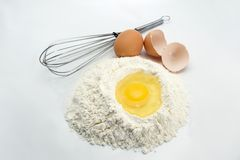 Eggs, flour and kitchen tools Stock Photo