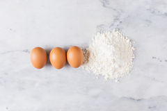 Eggs and flour royalty free stock photo