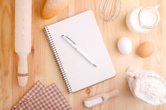 Eggs flour milk and whisk Royalty Free Stock Images