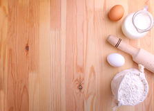 Eggs flour milk and whisk Stock Photography