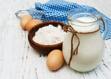 Eggs, flour, milk and wire whisk Royalty Free Stock Photos