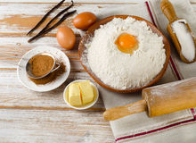 Eggs, flour, sugar, butter on  white  wooden table Stock Images