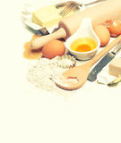 Eggs, flour, sugar, butter, yeast. dough preparation Royalty Free Stock Photography