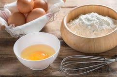 Eggs and flour on wood table. royalty free stock photos