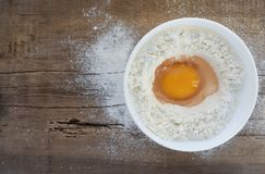 Eggs and flour on wooden table stock images