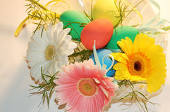 Eggs and flowers. Eggs and spring flowers for table decorations Stock Photos