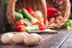 Eggs. Food ingredients: eggs and vegetables in a wicker basket Stock Image