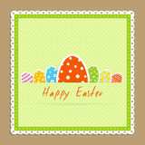 Eggs in frame. Happy easter celebration card - green textile napkin with many big and little easter colorful egg lie on beige backdrop vector illustration in Stock Image