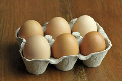 Eggs. Free range brown eggs in a recycled paper moulded or molded pulp cardboard egg box packaging Royalty Free Stock Photos