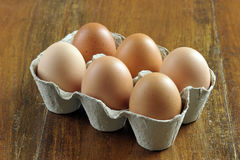 Eggs. Free range brown eggs in a recycled paper moulded or molded pulp cardboard egg box packaging Royalty Free Stock Images