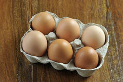 Eggs. Free range brown eggs in a recycled paper moulded or molded pulp cardboard egg box packaging Royalty Free Stock Image