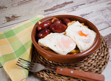 Eggs with french fries and small sausages Royalty Free Stock Photography