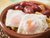 Eggs with french fries and small sausages. Stock Images