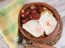 Eggs with french fries and small sausages. Stock Photography