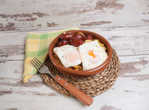 Eggs with french fries and small sausages. Royalty Free Stock Images