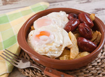 Eggs with french fries and small sausages Royalty Free Stock Photo