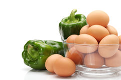 Eggs and fresh green paprika. On white background stock photo
