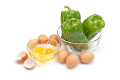 Eggs and fresh green paprika. On white background stock photos