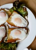 Eggs fried in bread. For breakfast Royalty Free Stock Photo