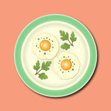 Fried eggs and fresh parsley on the plate Royalty Free Stock Images