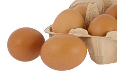 Eggs in front of a box Royalty Free Stock Photos