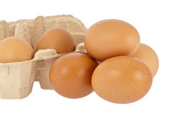 Eggs in front of a box Royalty Free Stock Photo