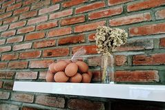 Eggs in front of the red brick stock images