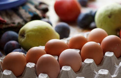 Eggs and fruits Royalty Free Stock Image