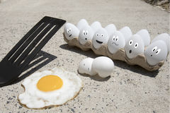 Eggs frying on sidewalk illustrated Stock Images