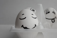Eggs funny with faces Concept sleep among noise Stock Images