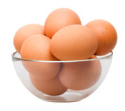 Eggs in glass bowl Stock Photos