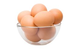 Eggs in glass bowl Royalty Free Stock Images