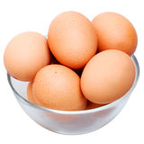 Eggs in glass bowl Stock Images