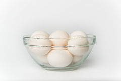 Eggs in Glass Bowl on White Background. Close up of Eggs in a glass bowl on a white background Stock Photography