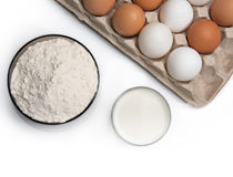 Eggs, glass of milk and flour Stock Photo