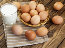 Eggs and a glass of milk Stock Photos