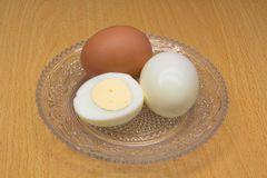 Eggs on a glass saucer stock photography