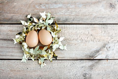 Eggs in gold nest Stock Photography