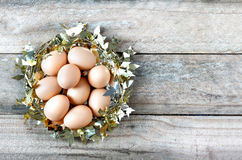 Eggs in gold nest Royalty Free Stock Images