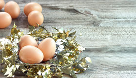 Eggs in gold nest Stock Image