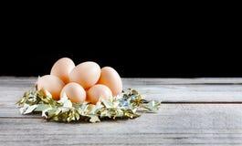 Eggs in gold nest Stock Photo