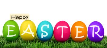 Eggs on grass with Happy Easter text Royalty Free Stock Photography