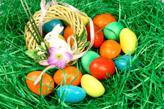 Eggs in the grass with a rabbit Stock Photos